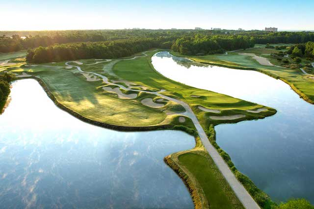 Aerial View of One Hole of the Dye Golf Course with lakes and bunkers